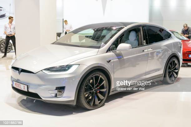 Tesla Model X P90D full electric luxury crossover SUV car front view The rear Falcon Wing doors are open The Model X P90D is the highest performance...