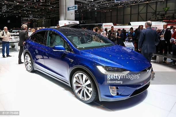 A Tesla Model X sport utility vehicle manufactured by Tesla Motors Inc sits on display on the first day of the 86th Geneva International Motor Show...