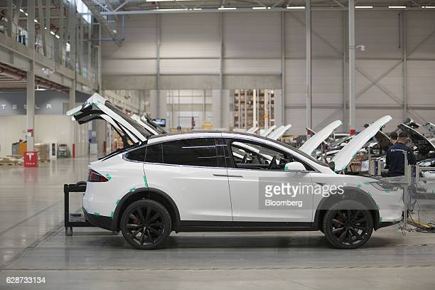 Tesla Model X sports utility vehicles stand on the factory floor ahead of assembly for the European market at the Tesla Motors Inc factory in Tilburg...