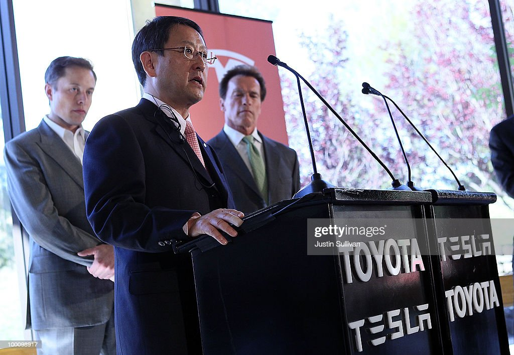 Tesla Motors CEO Elon Musk (L) and California governor Arnold Schwarzenegger (R) look on as Toyota CEO Akio Toyoda speaks during a news conference at Tesla Motors headquarters May 20, 2010 in Palo Alto, California. Electric car maker Tesla Motors annoucned a partnership with Japanese automaker Toyota to make electric cars in the United States. The cars will be manufactured at the recently shuttered NUMMI plant in Fremont, California where Toyota had pulled out after a joint partnership with General Motors had ended.