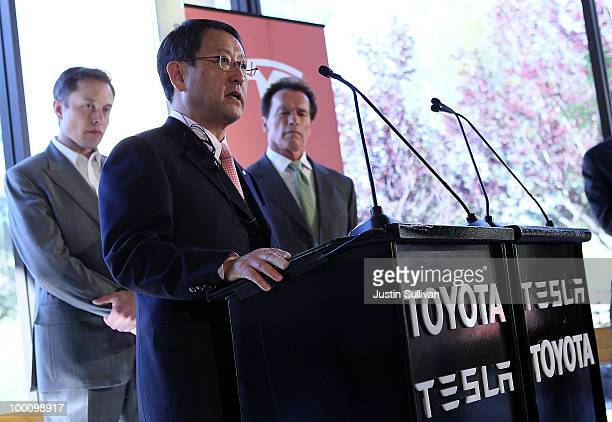Tesla Motors CEO Elon Musk and California governor Arnold Schwarzenegger look on as Toyota CEO Akio Toyoda speaks during a news conference at Tesla...