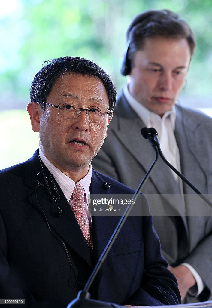 Tesla Motors CEO Elon Musk (R) looks on as Toyota CEO Akio Toyoda speaks during a news conference at Tesla Motors headquarters May 20, 2010 in Palo Alto, California. Electric car maker Tesla Motors annoucned a partnership with Japanese automaker Toyota to make electric cars in the United States. The cars will be manufactured at the recently shuttered NUMMI plant in Fremont, California where Toyota had pulled out after a joint partnership with General Motors had ended.