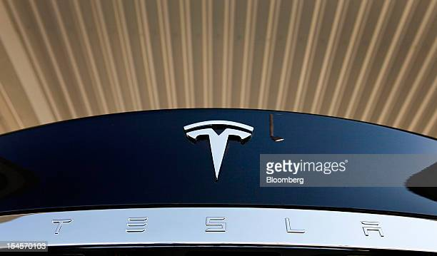 Tesla Motors Inc logo is seen on a Model S sedan after the grand opening of the Tesla Supercharger station in Lebec California US on Friday Oct 19...