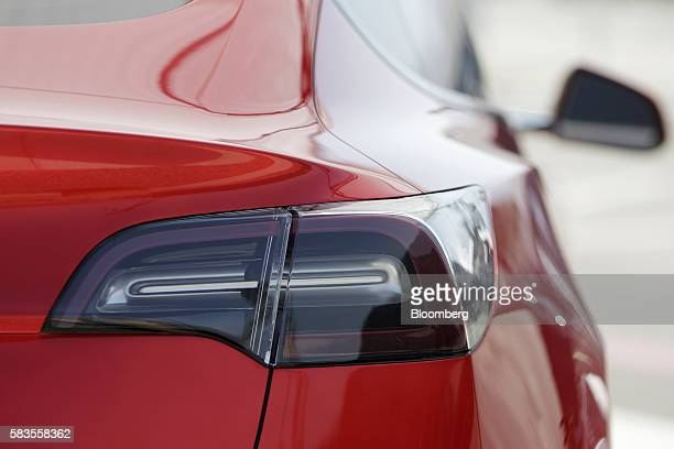 A Tesla Motors Inc Model 3 vehicle stands outside the company's Gigafactory in Sparks Neveada US on Tuesday July 26 2016 Tesla officially opened its...