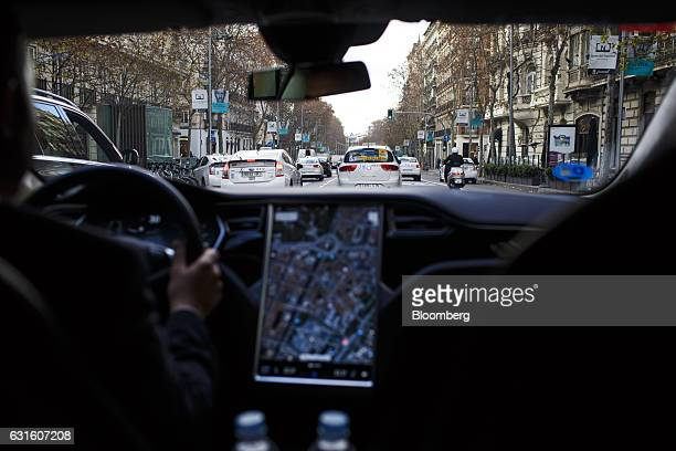 A Tesla Motors Inc Model S electric automobile operated Uber Technologies Inc drives through traffic in Madrid Spain on Friday Jan 13 2017...