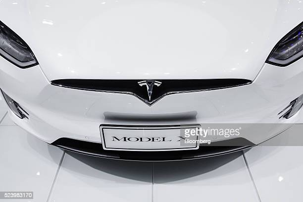 A Tesla Motors Inc Model X electric sport utility vehicle stands on display at the Beijing International Automotive Exhibition in Beijing China on...