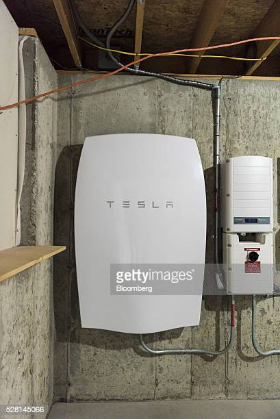 A Tesla Motors Inc Powerwall unit sits inside a home in Monkton Vermont US on Monday May 2 2016 A year after Elon Musk unveiled the Powerwall at...