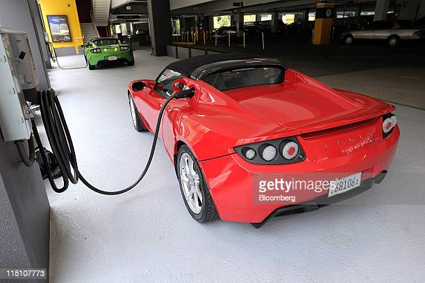 Tesla Motors Inc Roadster electric sports vehicles are charged at the automakers showroom in San Jose California US on Thursday June 2 2011 Tesla...