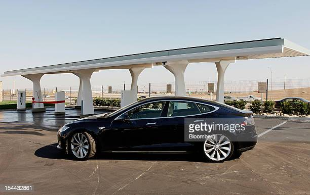 A Tesla Motors Inc S sedan stands before the grand opening of the Tesla Supercharger station in Lebec California US on Friday Oct 19 2012 Tesla...