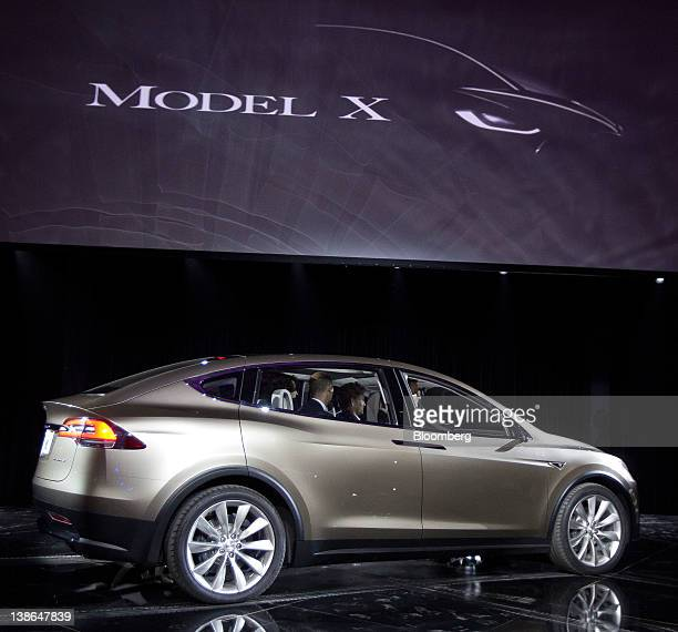 Tesla Motors Inc's Model X vehicle is unveiled at Tesla's design studio in Hawthorne California US on Thursday Feb 9 2012 The Model X touted by Tesla...