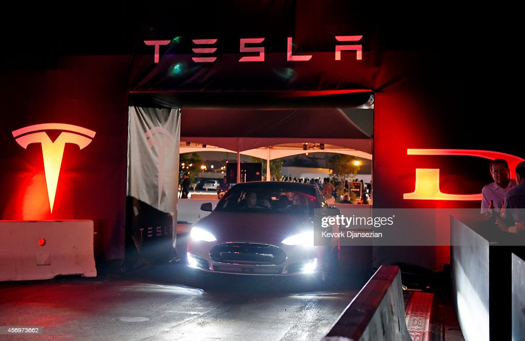 Tesla owners take a ride in the new Tesla 'D' model electric sedan after Elon Musk, CEO of Tesla, unveiled the dual engine chassis of the new Tesla 'D' model, a faster and all-wheel-drive version of the Model S electric sedan, at the Hawthorne Airport October 09, 2014 in Hawthorne, California. The D will be able to accelerate to 60 miles per hour in just over 3 seconds.