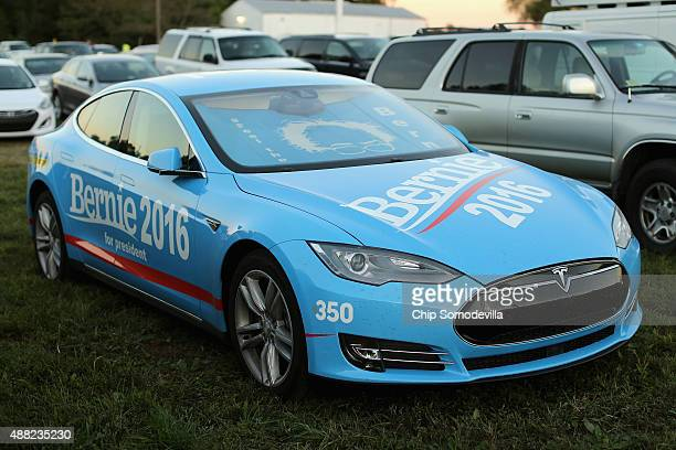 Tesla sports car is covered in campaign logos for Democratic presidential candidate Sen Bernie Sanders at a campaign rally at the Prince William...