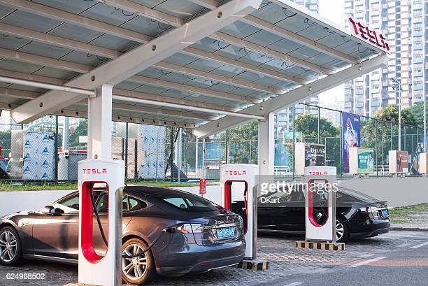 tesla supercharger parking - supercharged engine stock pictures, royalty-free photos & images