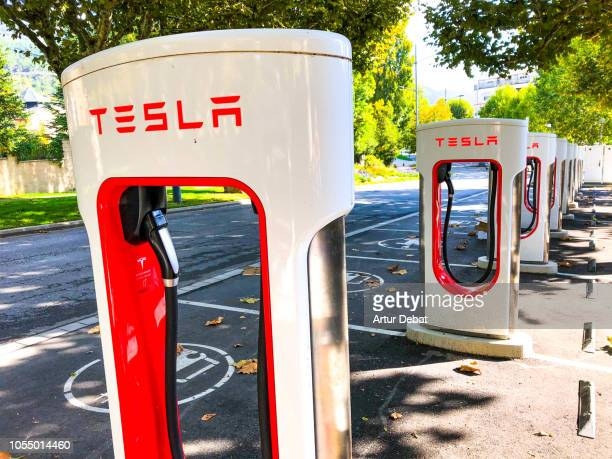 tesla supercharger station. - supercharged engine stock pictures, royalty-free photos & images