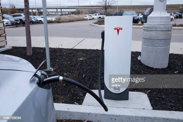 Tesla Vehicles are Charging at the Mall Parking Lot in Toronto, Ontario