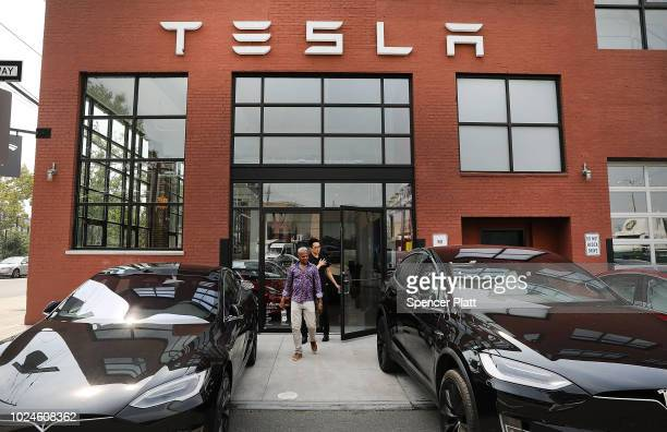Tesla vehicles stand outside of a Brooklyn showroom and service center on August 27, 2018 in New York City. The electric automaker saw its stock drop...