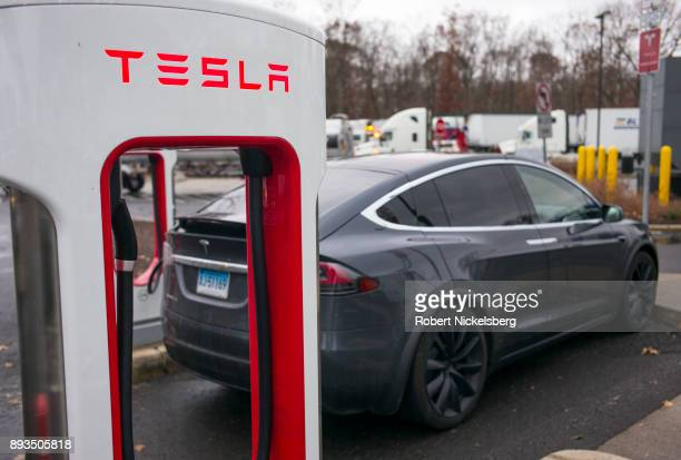 Tesla X electric automobile recharges at a public charging station along Interstate 95 December 5 2017 in Darien Connecticut Using the roadside 480...