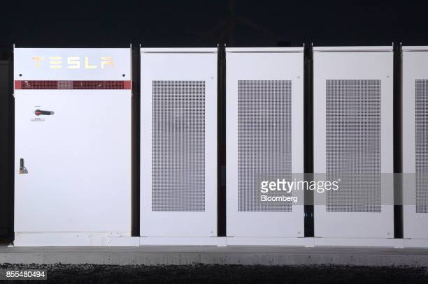 TeslaInc Powerpacks that will be used to form theworld's largestlithiumionbattery stand on display at the Hornsdale wind farm operated by Neoen...