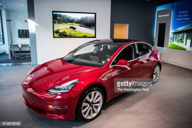 Tesla's new Model 3 car on display is seen on Friday January 26 at the Tesla store in Washington DC