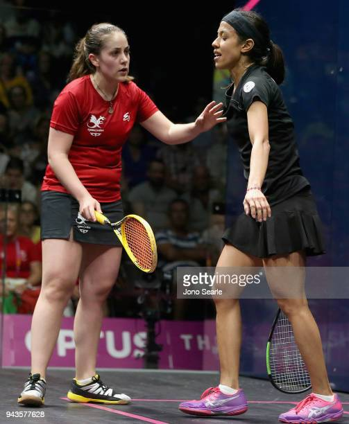 Tesni Evans of Wales consoles opponent Nicol David of Malaysia during squash in the women single Bronze Medal match on day five of the Gold Coast...