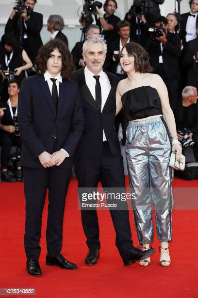 Tess Bu Cuaron Alfonso Cuar—n and Olmo Teodoro Cuaron walk the red carpet ahead of the 'Roma' screening during the 75th Venice Film Festival at Sala...
