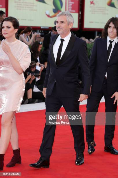 Tess Bu Cuaron Alfonso Cuaron and Olmo Teodoro Cuaron of the Netflix movie Roma walk the red carpet ahead of the Award Ceremony during the 75th...