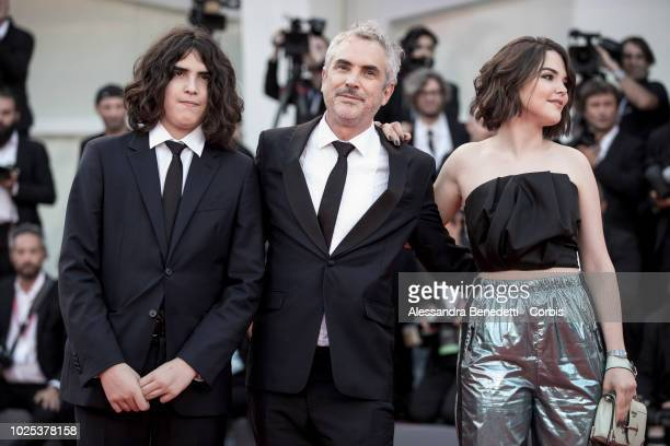 Tess Bu Cuaron Alfonso Cuaron and Olmo Teodoro Cuaron walk the red carpet ahead of the 'Roma' screening during the 75th Venice Film Festival at Sala...