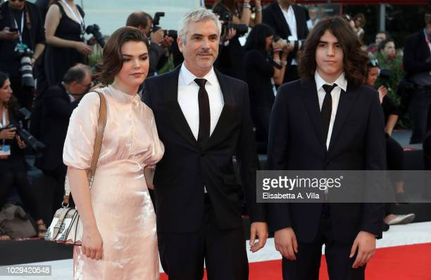 Tess Bu Cuaron Alfonso Cuaron and Olmo Teodoro Cuaron walk the red carpet ahead of the Award Ceremony during the 75th Venice Film Festival at Sala...