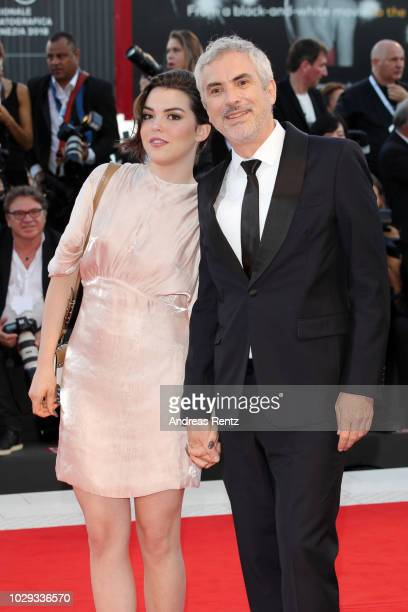 Tess Bu Cuaron and Alfonso Cuaron of the Netflix movie Roma walk the red carpet ahead of the Award Ceremony during the 75th Venice Film Festival at...