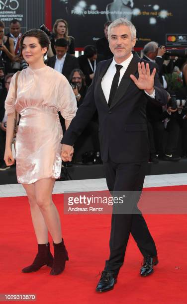Tess Bu Cuaron and Alfonso Cuaron walk the red carpet ahead of the Award Ceremony during the 75th Venice Film Festival at Sala Grande on September 8...
