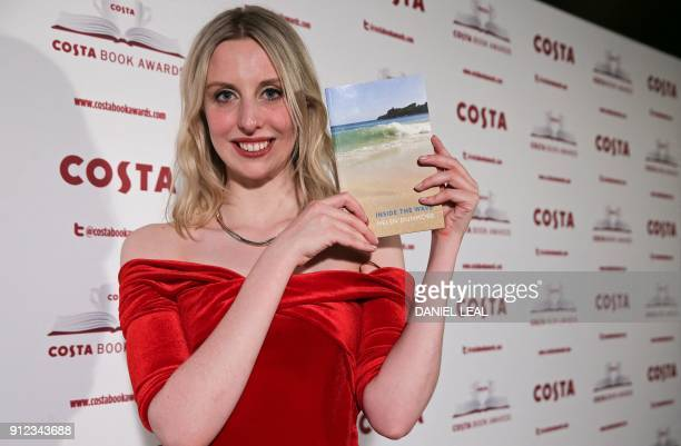 Tess Charnley daughter of the late British poet and author Helen Dunmore poses with Helen's 'Poetry' Award winning book 'Inside the Wave' after...