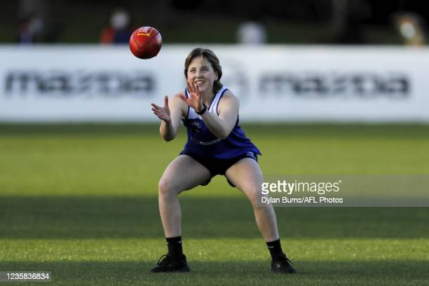 Tess Craven of the Kangaroos marks the ball during the North Melbourne training session at Arden Street Oval on October 12, 2021 in Melbourne,...