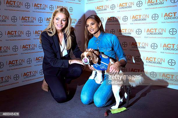 Tess Daly and Alesha Dixon pose for photographers to highlight the Be Lungworm Aware campaign urging dog owners to speak to their vet about the...