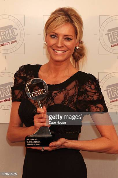 Tess Daly poses with the best reality programme for Strictly Come Dancing in the press room at the TRIC Awards 2010 held at The Grosvenor House Hotel...