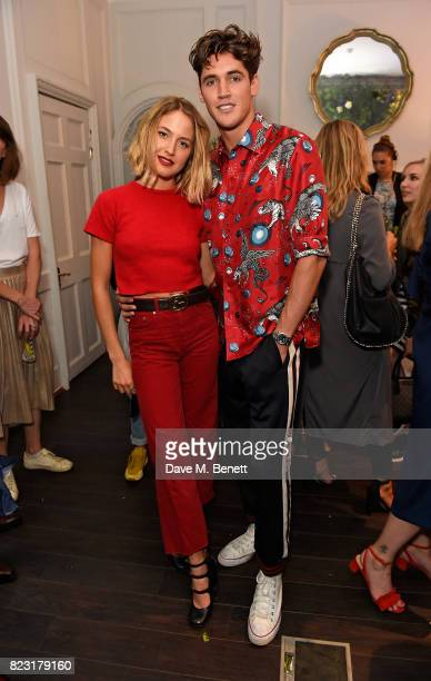 Tess Ward and Isaac Carew attend the Maison StGermain opening night at 2 Soho Square on July 26 2017 in London England