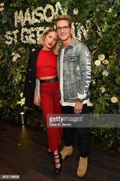 Tess Ward and Oliver Proudlock attend the Maison StGermain opening night at 2 Soho Square on July 26 2017 in London England