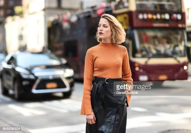 Tess Ward at New York Fashion Week wearing a Karen Millen sweater and skirt on September 10 2017 in New York City