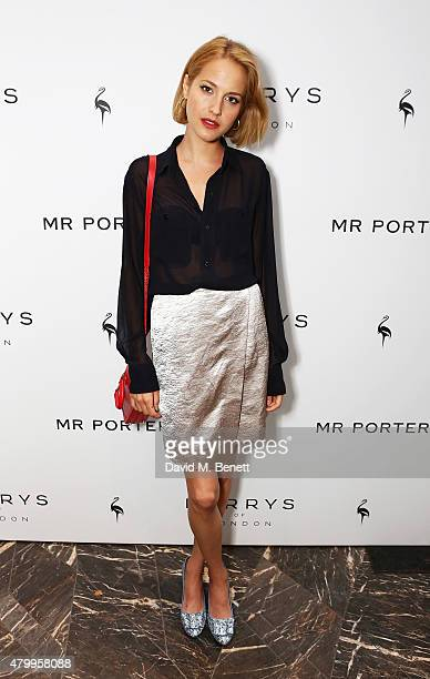 Tess Ward attends the summer dinner hosted by Harrys of London and Mr Porter at Burlington Arcade on July 8 2015 in London England