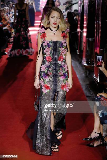 Tess Ward walks the runway at the Dolce Gabbana secret show during Milan Fashion Week Spring/Summer 2018 at Bar Martini on September 23 2017 in Milan...