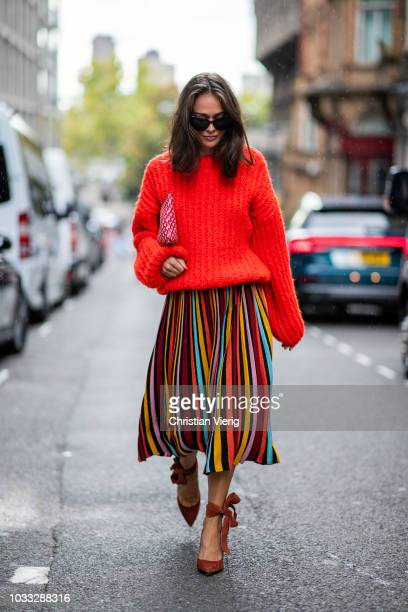 Tess wearing red knit striped multi color skirt heels seen outside Marta Jakubowski during London Fashion Week September 2018 on September 14 2018 in...
