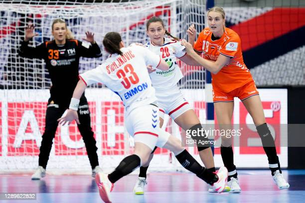 Tess Wester and Kelly Dulfer of Netherlands defend Jovana Stoiljkovic and Sladana Pop of Serbia during the Women's EHF Euro 2020 match between...