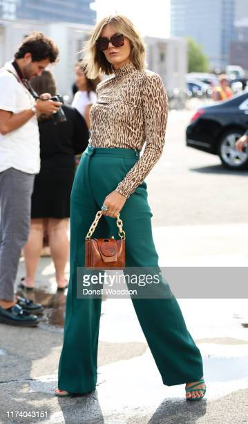 Tessa Barton is seen wearing a cheetah print top and teal pants during New York Fashion Week on September 11, 2019 in New York City.