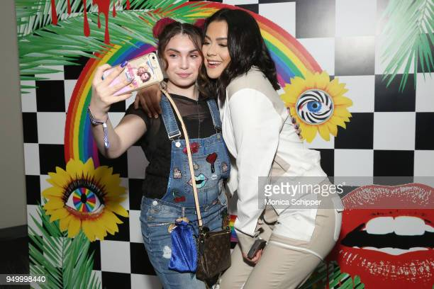 Tessa Brooks poses with fans at a Meet Greet during Beautycon Festival NYC 2018 Day 2 at Jacob Javits Center on April 22 2018 in New York City