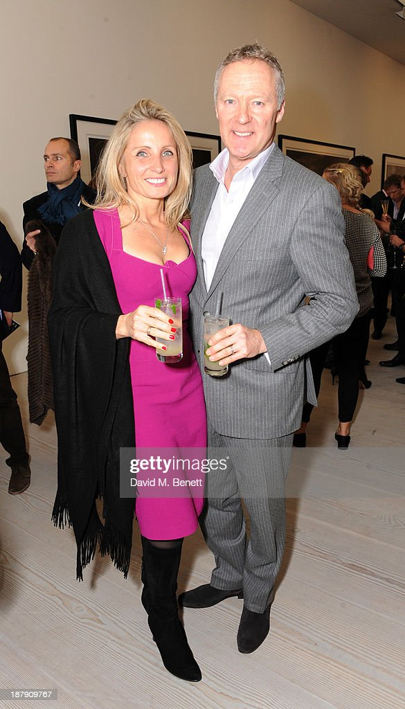 Tessa Campbell Fraser and Rory Bremner attend the private view of ENCOUNTER the stunning wildlife photography of David Yarrow at Saatchi Gallery on November 13, 2013 in London, England.