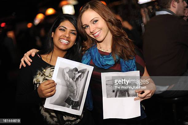 Tessa Jarrett from Fairfax VA right holds a picture of her exboyfriend David in her hand while hugging her friend Joya Patel from Burke VA who holds...