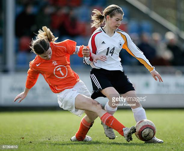 Tessa Oudejans of the Netherlands tackles MarieLouise Bagehorn of Germany during the Women's Under 15 International friendly match between...