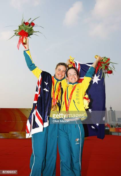 Tessa Parkinson and Elise Rechichi of Australia celebrate with their gold medals after winning the Women's 470 class event held at the Qingdao...