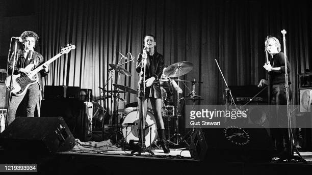 LR Tessa Pollitt Ari Up and Viv Albertine of British punk band The Slits perform on stage at the Coliseum Harlesden London 11th March 1977
