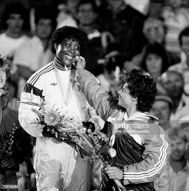 Tessa Sanderson is congratulated on her Olympic Gold medal by fellow British javelin thrower Fatima Whitbread who won bronze in the event Los Angeles...