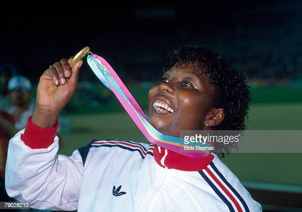 Tessa Sanderson of Great Britain proudly displays her gold medal on the podium after winning the Women's javelin throw event at the 1984 Summer...